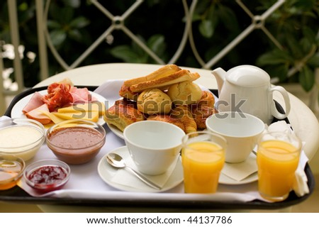 Tasty breakfast for two on the balcony or in the garden