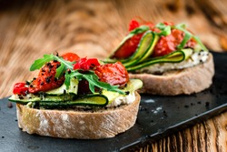 Tasty bruschetta with tomato. Easy cook, nutritious snack. Beautifully decorated catering banquet menu. Food snacks and appetizers for buffet. bruschetta with tomato and cucumber
