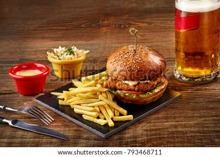 tasty burger  french fries with ...