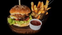 Tasty Burger with ketchup and fries, fries and chicken burger, ham burger, potato fries, burger with black background picture.