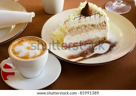 tasty cake at plate closeup with coffee cup
