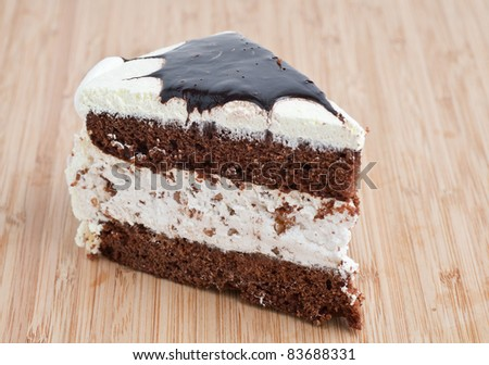 Tasty Chocolate Cake Slice on a wooden board