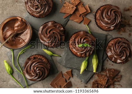 Tasty chocolate cupcakes on table, top view