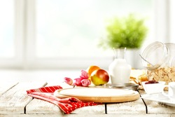 Tasty continental breakfast and blurred window background with green plant. Free space for your decoration.
