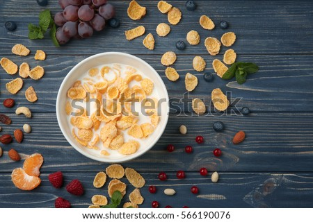 Tasty cornflakes with milk on gray background #566190076