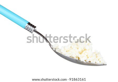 Tasty cottage cheese in spoon isolated on white