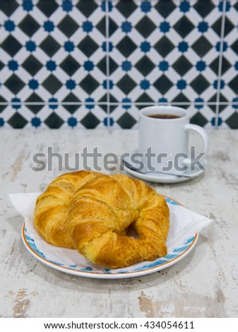 Stock Photo Tasty croissants with cup of tea. Spanish breakfast.