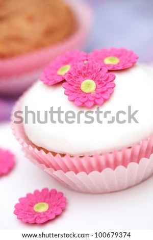Tasty cupcake with floral decoration
