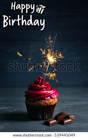 Tasty Cupcake With Sparkler On Table Text HAPPY BIRTHDAY Background 539445049