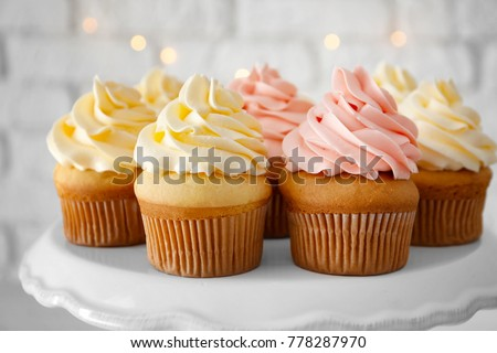 Tasty cupcakes on stand