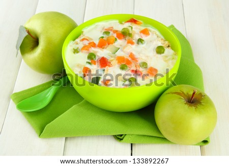 tasty dieting food and apples on wooden table