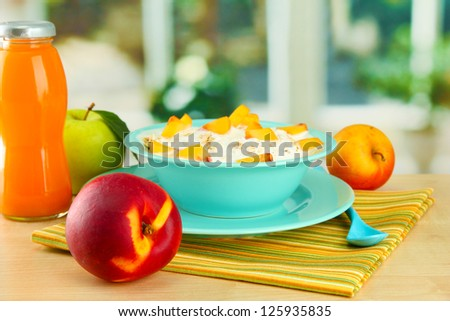 tasty dieting food and bottle of juice, on wooden table