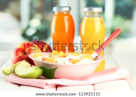 tasty dieting food and bottles of juice, on wooden table