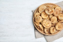 Tasty dried figs on white wooden table, top view. Space for text