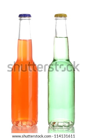 Tasty drinks in bottles isolated on white
