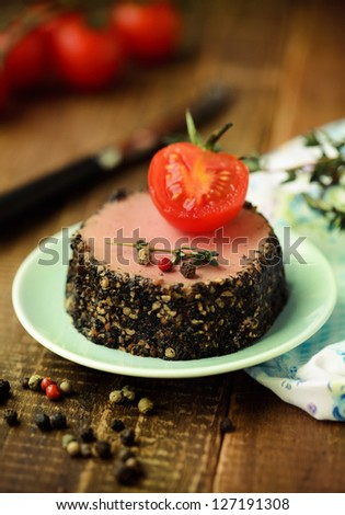 Tasty duck pate appetizer with fresh herbs and tomatoes
