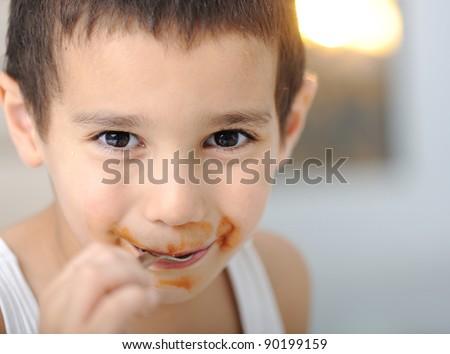 Tasty food, messy child eating spaghetti