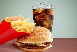Tasty fresh burger, fries and coke on the wood table