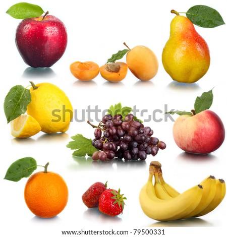 Tasty fresh fruit and berries. An apple, a pear, a peach, an apricot, grapes, a strawberry, an orange, a lemon. - stock photo