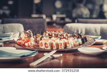 Tasty fresh Japanese sushi with tuna, caviar and shrimps