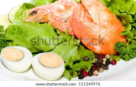 Tasty fried prawn food with salad and eggs