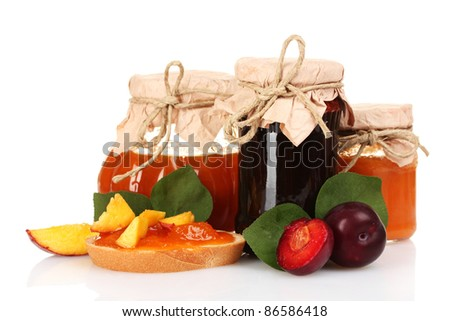 tasty fruit and berry jam isolated on white