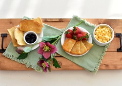 Tasty gourmet classic American breakfast room service with bacon, eggs, toast, fruit, mimosa. Top view, photo concept, background, copy space