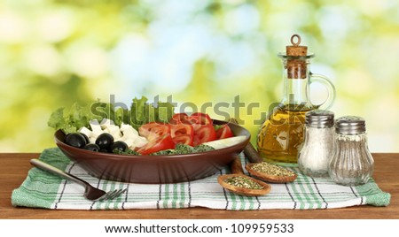 tasty greek salad on bright green background