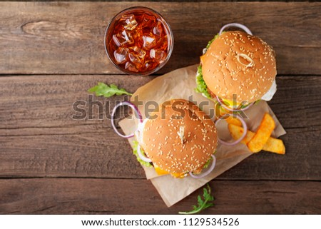 Tasty grilled burgers with pork meat, tomato, cheese, cucumber and lettuce. Top view #1129534526