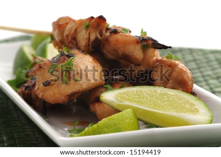 Tasty grilled chicken satay with fresh lime.