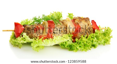 tasty grilled meat and vegetables on skewer, isoalted on white