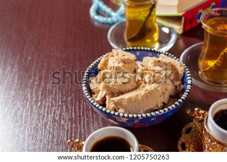 Tasty halva with tea on the table #1205750263