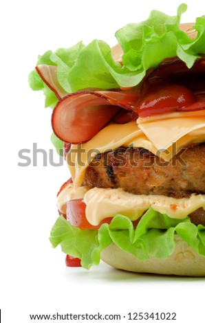 Tasty Hamburger with Bacon, Beef, Cheese, Tomato, Lettuce, Mayonnaise and Ketchup closeup on white background