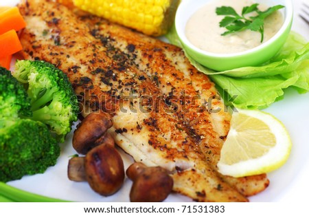 Tasty healthy fish fillet with steamed vegetables