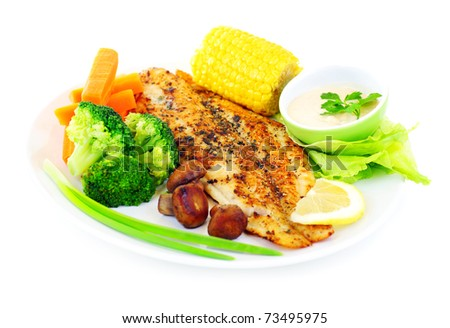 Tasty healthy fish fillet with steamed vegetables, isolated on white background