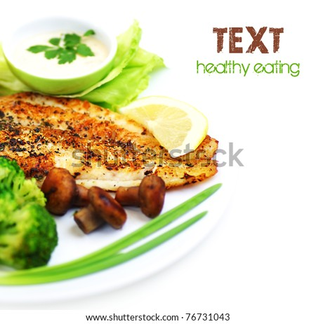 Tasty healthy fish fillet with steamed vegetables, isolated on white background, border with text space