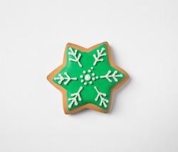 Tasty homemade Christmas cookie on white background, top view
