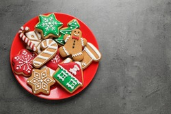 Tasty homemade Christmas cookies on grey table, top view. Space for text