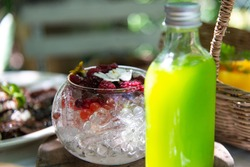 Tasty homemade fresh fusion fruits water with mix berries and ice.