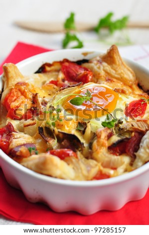tasty homemade quiche with parma ham, tomatoes and eggs