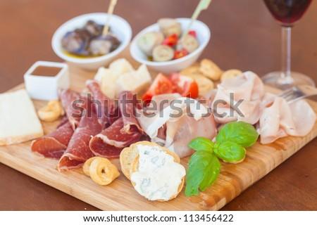 Tasty italian aperitif on chopping board