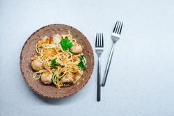 tasty italian homemade pasta with chanterelles, turkey meat balls and creamy sauce