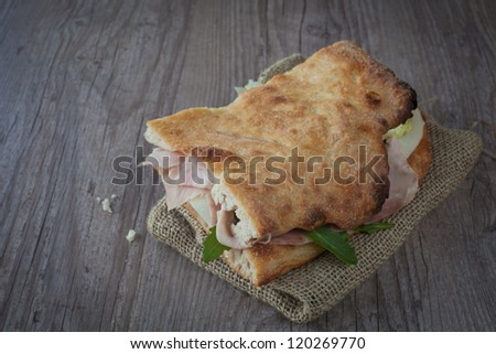 Tasty italian sandwich with ham and cheese