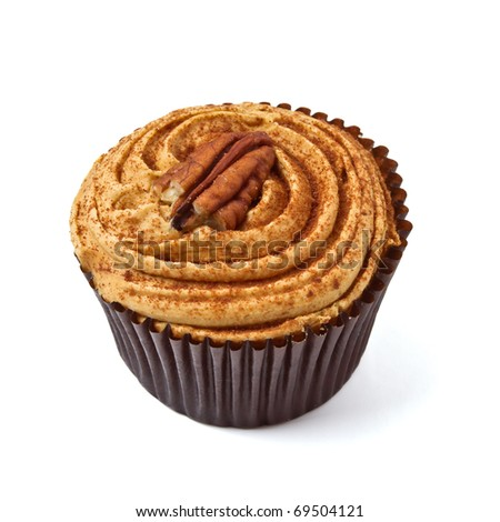 tasty looking Pecan and Caramel cup cake isolated on white.