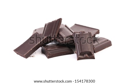 Tasty morsel of dark chocolate. Isolated on a white background.