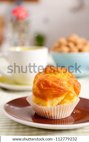 Tasty muffin and a cup of hot tea