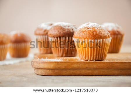 Tasty muffin closeup on a wooden board, selective focus. Photo stock ©