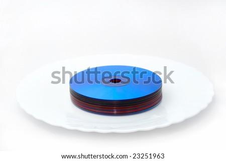 Tasty multimedia technologies: color dvd bundle on white plate