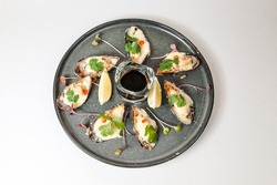 Tasty mussels with cheese and sauce