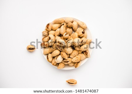 tasty nutritious shell almonds on a white background
